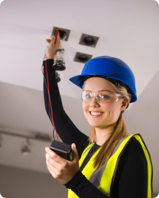 a young woman fixing ceiling lights