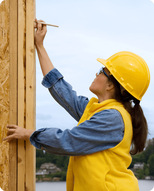 a woman in yellow safety gears measuring the height