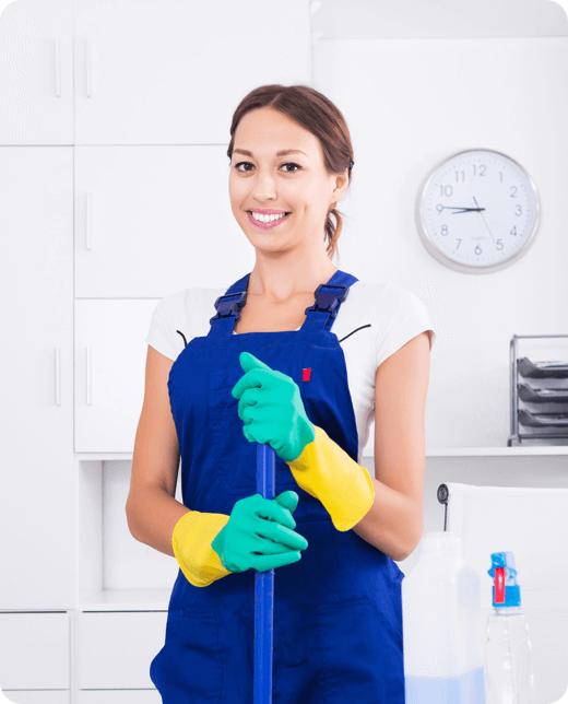 a smiling woman holding the handle of the mop