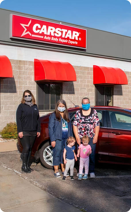 family members standing near a car