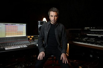 French composer, performer and music producer Jean-Michel Jarre poses at his recording studio in Bougival, west of Paris, on September 30, 2015. AFP PHOTO / THOMAS SAMSON  THOMAS SAMSON / AFP