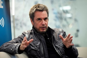 French electronic musician Jean-Michel Jarre answers questions during an interview with Agence France-Presse in New York on May 12, 2017.  Jarre, one of the pioneers of electronic music, will perform at Radio City Music Hall in New York on May 20 as part of his first-ever tour of North America. The French artist has arranged some of the largest concerts in music history with elaborate light shows over cities such as Moscow and Houston but has never previously gone on a tour of North America. JEWEL SAMAD / AFP