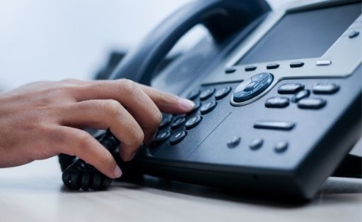 Transferring a call to the answering service.