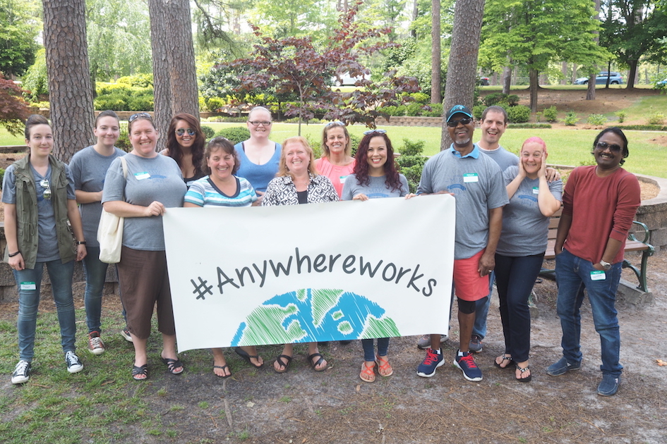AnswerConnect's Wilmington answering service team with Anywhere Works banner