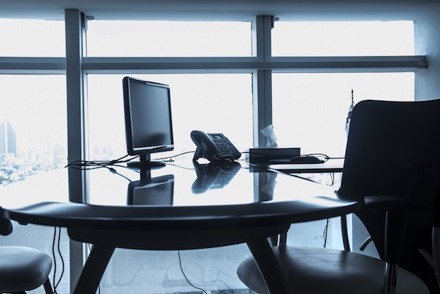 an empty desk signifying virtual receptionist