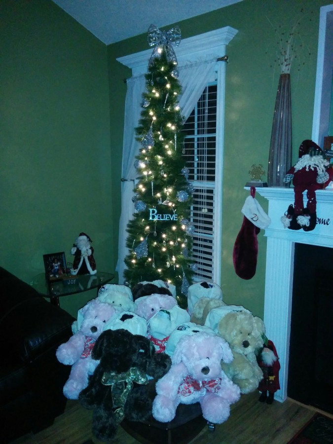Teddy bears under a Christmas tree