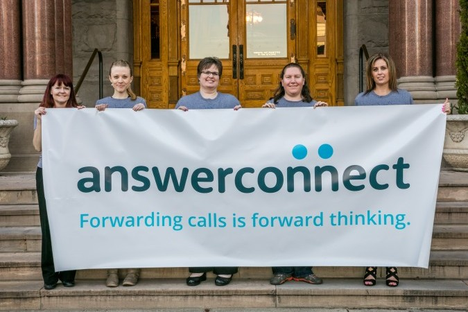 answerconnect team with banner in utah