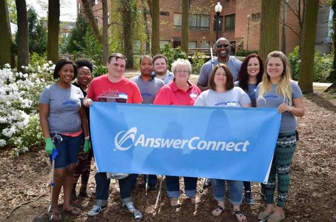 AnswerConnect Fayetteville team with banner