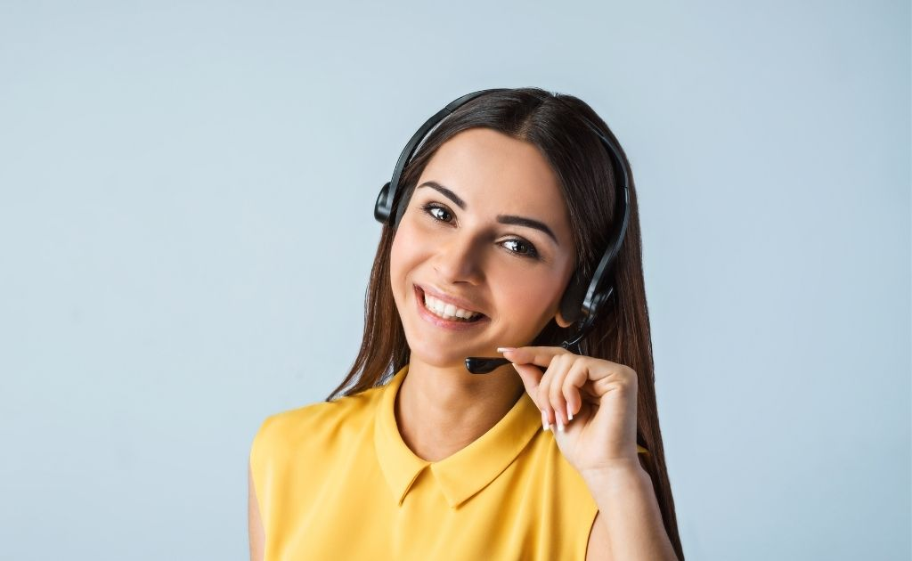 Woman working as a virtual receptionist, dealing with an angry caller, using a headset