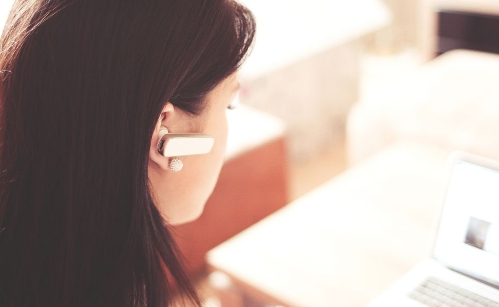Woman answering calls on behalf of her customers, who use virtual assistants services.