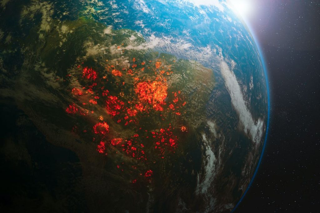 """Shot of forest burning on planet """"Why we need tree planting initiatives"""""""
