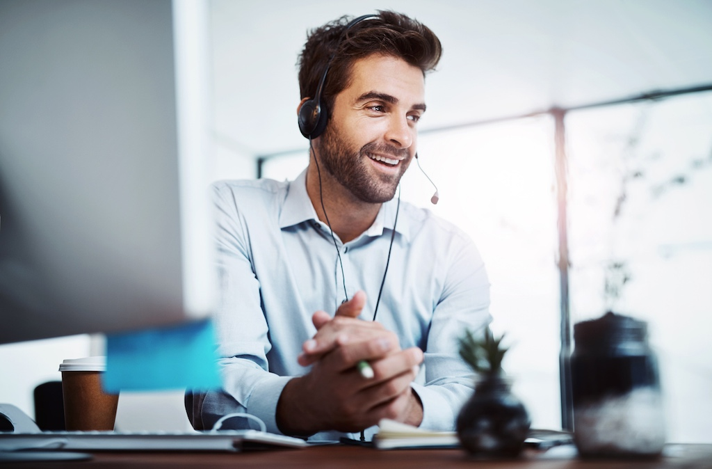 Man speaking to callers as part of lead qualification answering service
