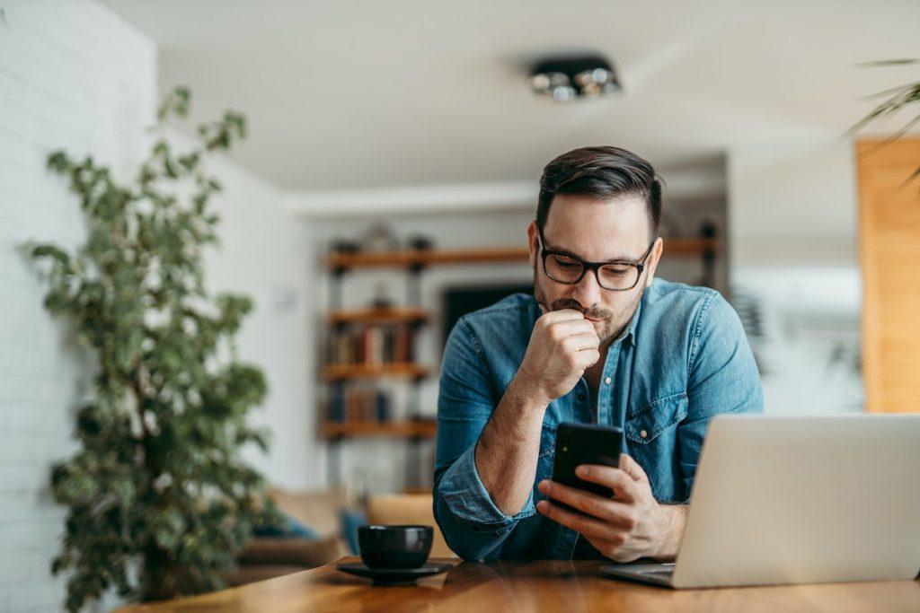 Man looking at phone learning for studying time