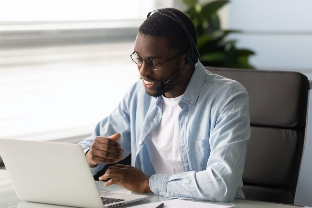 Smiling man acting as virtual receptionist at answering service for small business