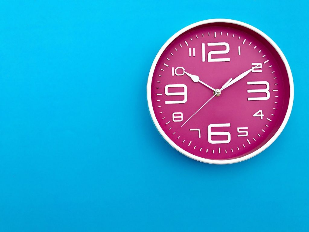 Clock on wall representing time tracking for appointment scheduling service