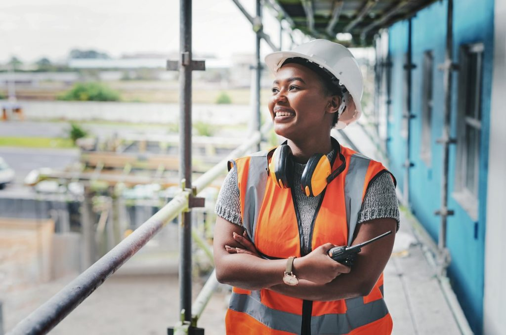 Smiling site manager on building site