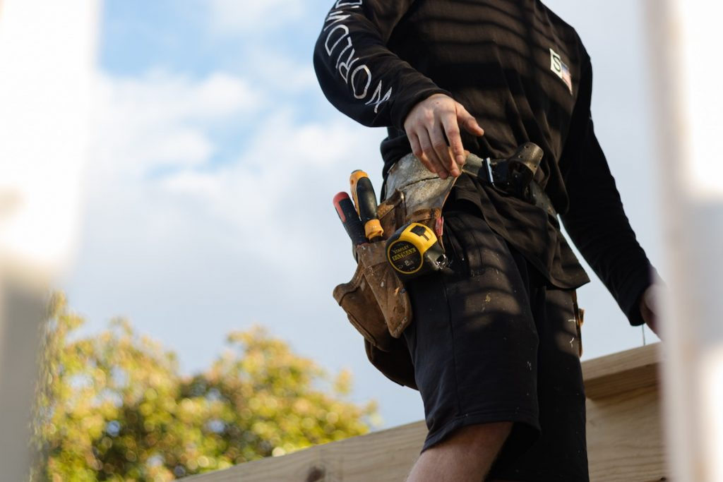 Builder with tool belt outdoors