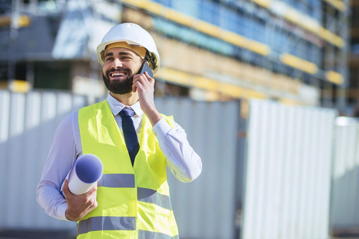 Contractor working on building site using contractor answering service