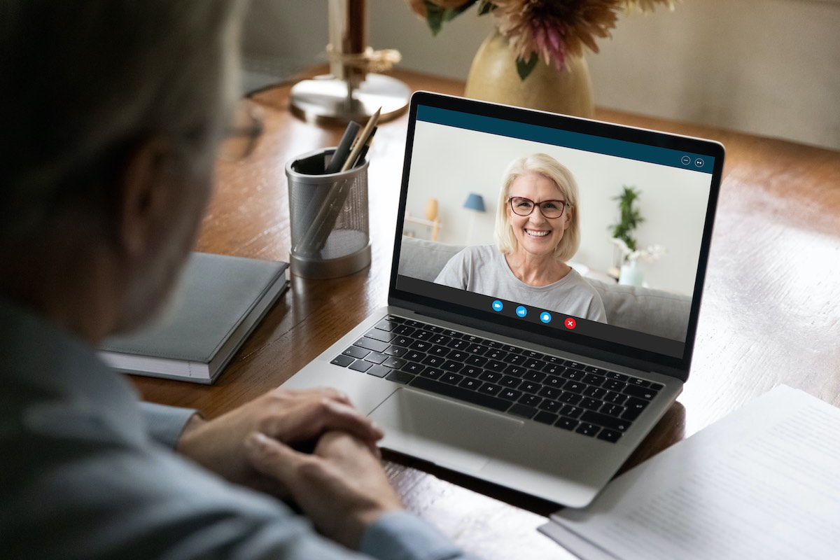 Woman in video meeting with colleague