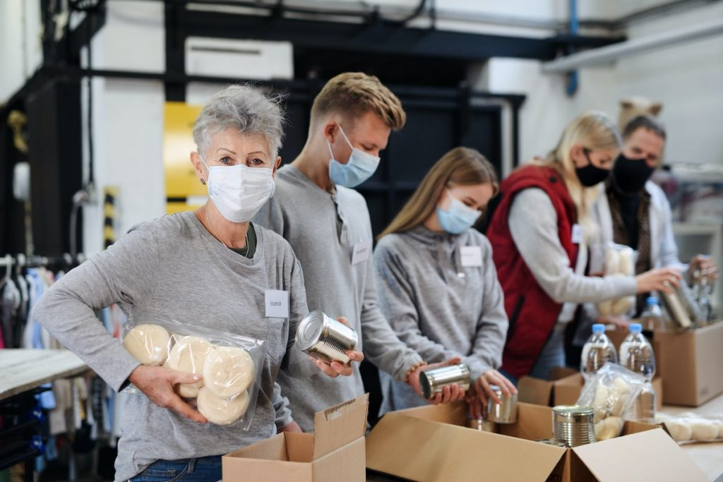Business team packing food boxes for employee volunteer program
