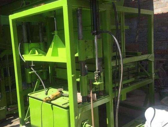 Maquina para fabricar bloques de construccion