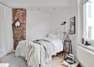 Chunky blankets and minimalist accents make this bedroom very hygge