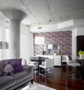 Gorgeous purple wallpaper and accents bring this room together