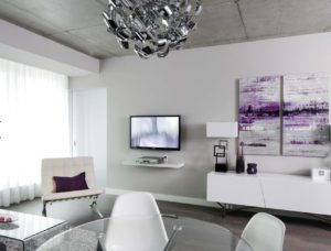 Purple provides just the right notes to bring life to this minimalist space