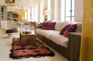 Warm tie dye colors add a pop of color to this open plan space