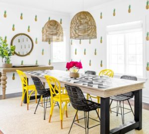 The tropical trend meets minimalism in this fun dining room