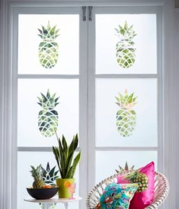 Pineapple frosted glass sets the tone for this tropical space