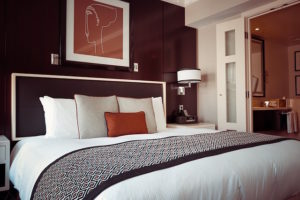 A dark accent wall helps bring out the other lighter tones