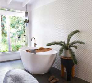 A minimalist bathroom is enhanced by jungle decor