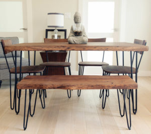 A combination of dining chairs and dining benches makes a versatile arrangement