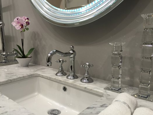 3 hole washbasin tap with crystal knobs on a country style vanity unit