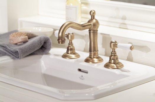 Light bronze three hole basin mixer on vanity unit