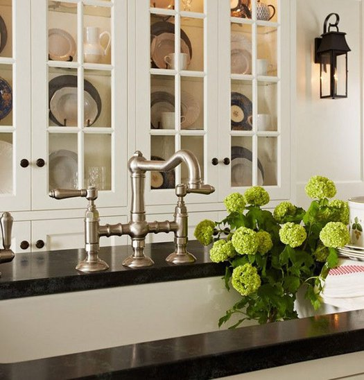 Elegant bridge kitchen faucet with hand shower in a countrystyle kitchen