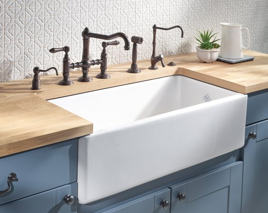 Elegant kitchen faucet and sink in a retro style kitchen