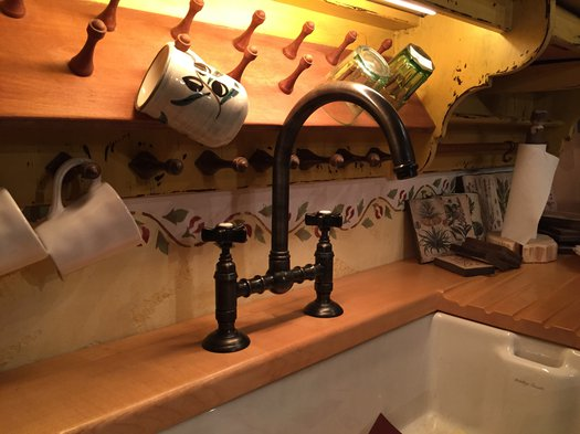 Retro kitchen with rustic faucet available in more than 20 finishes