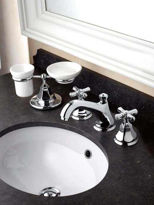 Classic 3-hole mixer tap on a piece of furniture with granite countertop