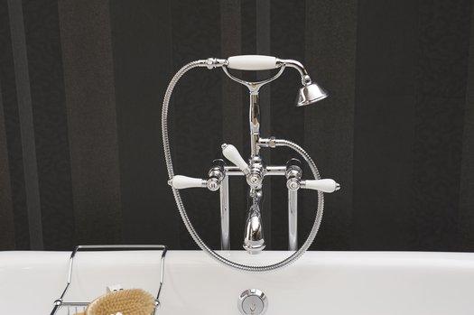 Rustic looking bath mixer with bathtub on feets