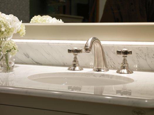Vintage 3 holes tap on a retro bathroom vanity unit