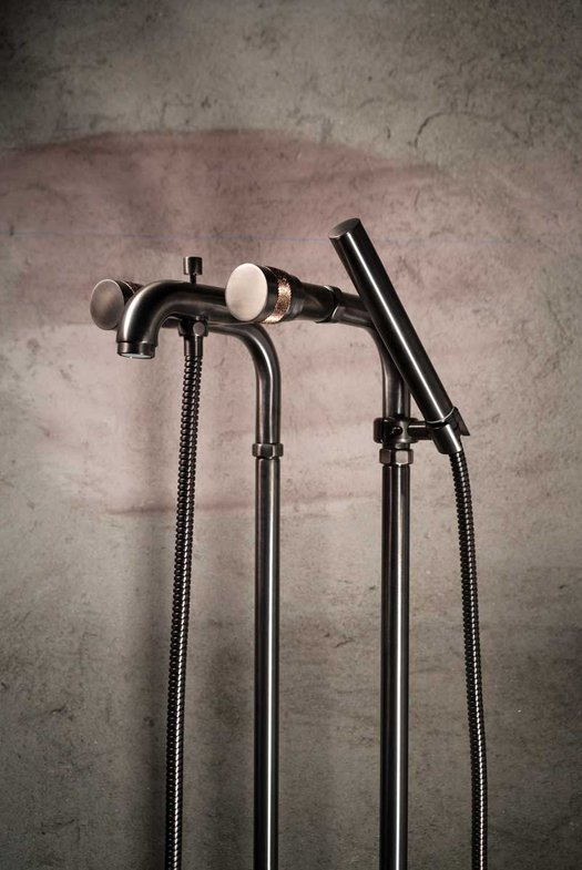Bath mixer on standing fittings for the design bathroom