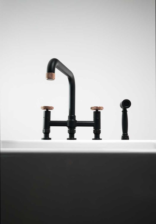 Trendy industrial style kitchen faucet with hand shower