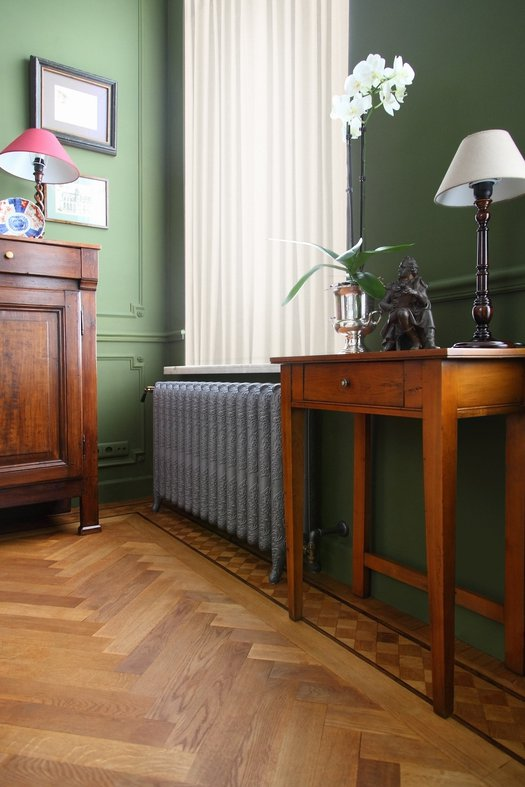 Classic cast iron radiators with elegant floral pattern