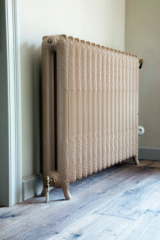 Cast iron radiator in classical style with floral pattern