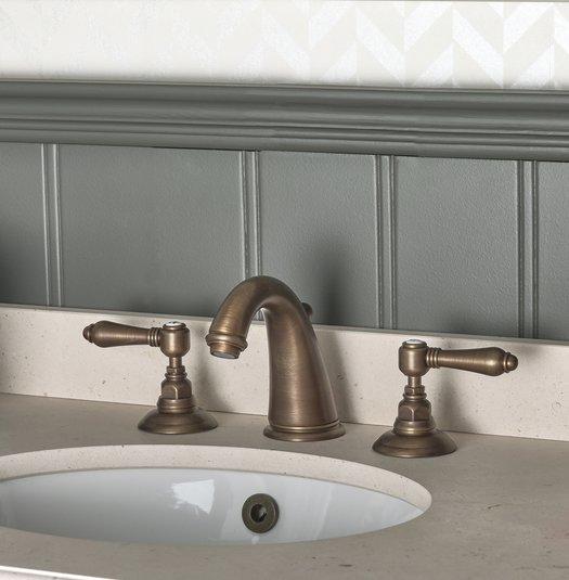 Detail of a three holes washbasin mixer on a Elysée vanity unit