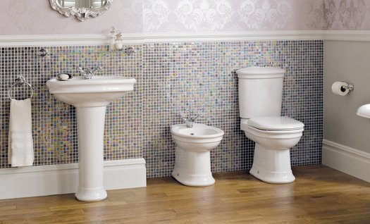 Bathroom with ceramic toilet and washbasin in vintage style