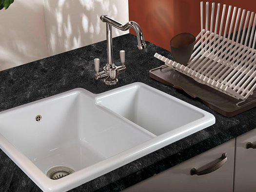 Trendy inset sink in a granite kitchen tablet