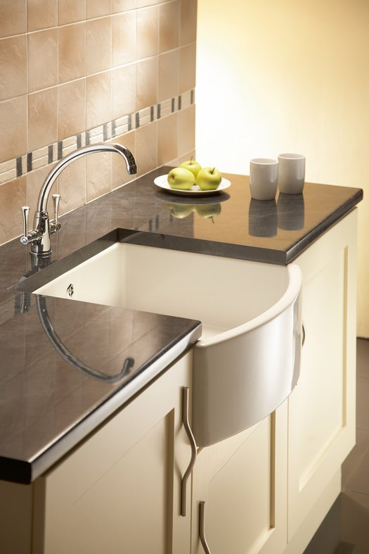 Elegant kitchen sink with curved front